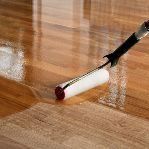 A Wood Floor Receives a Coat of Lacquer.