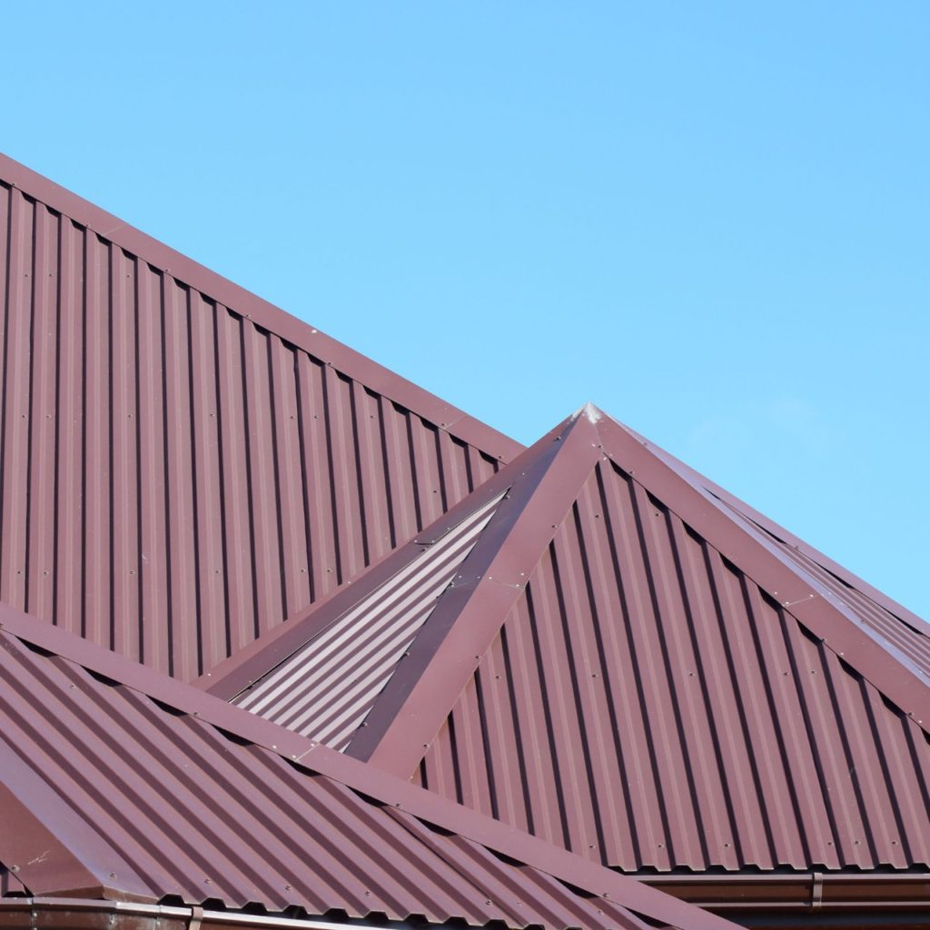 maroon brown metal roof installed on home