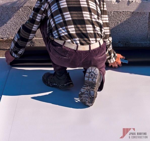 Roofer Installing Flat Roof Coating