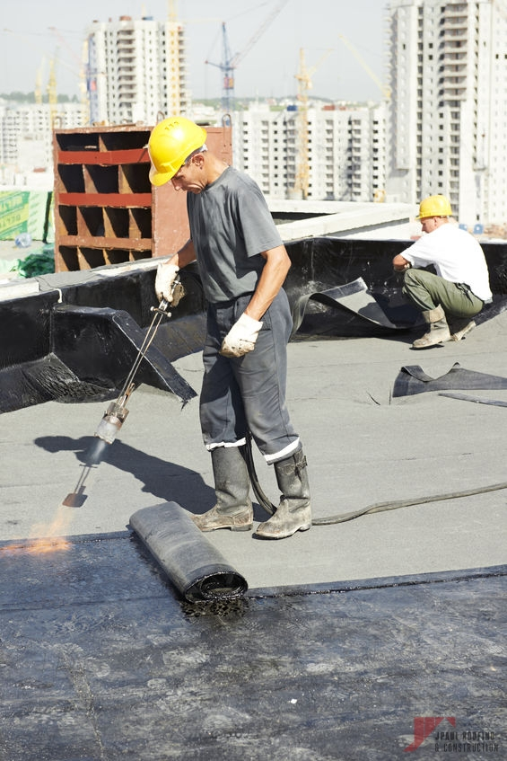 Roofer Completing Emergency Commercial & Residential Roof Repair