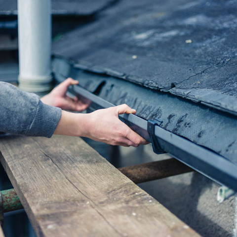 checking gutters on a roof