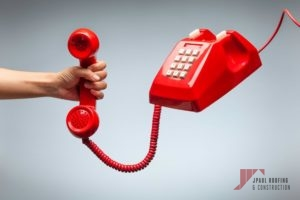 Hand holding telephone, classic red telephone receiver, old telephone isolated on white background flying in weightlessness.