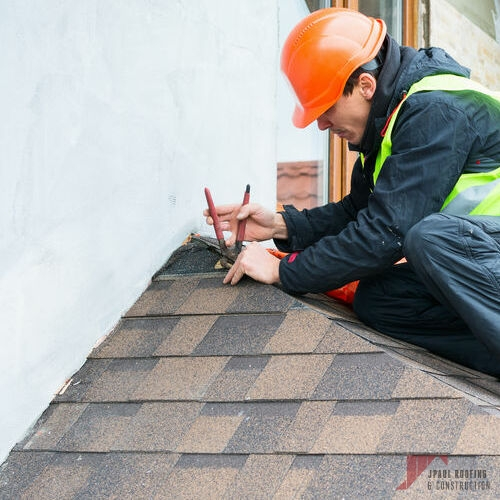 Contractor Working on Emergency Commercial & Residential Roof Repair