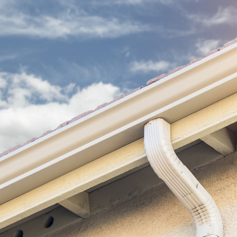 white gutters with roof drainage