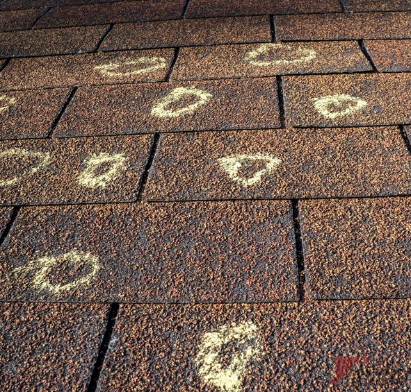 Marked Hail Damage on Roof That Can Cause Need for Leaking Roof Repair