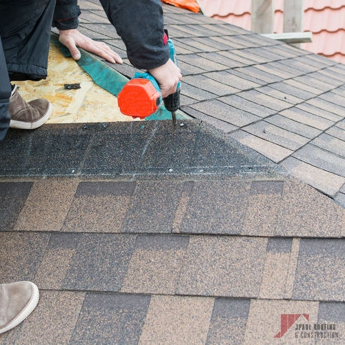 Contractor Working on Impact Resistant Shingle Installation