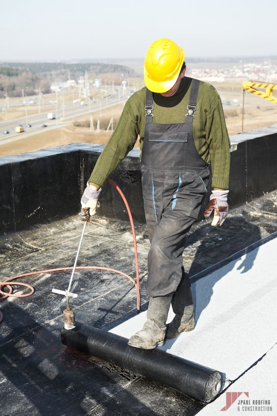 Rolling Out Flat Roof Coating