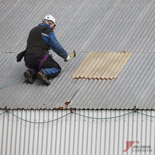 Working on Emergency Commercial & Residential Roof Repair
