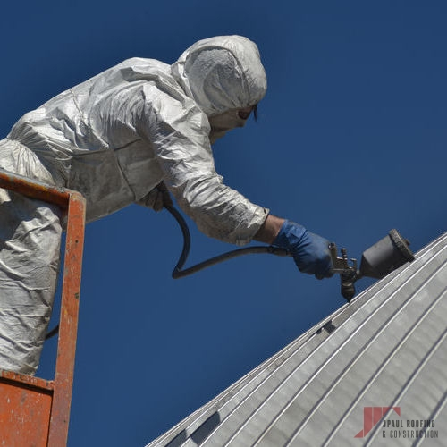 Roofer Applying Metal Roof Coating