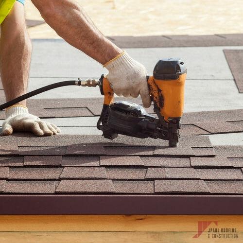 Residential Roofer Installing Asphalt Shingles