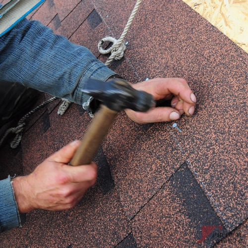Roofer Working on Emergency Commercial & Residential Roof Repair