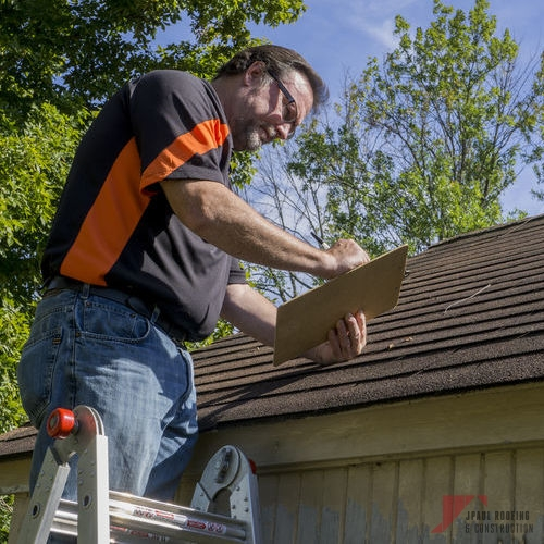 Inspector Examining Roof for Roof Insurance Claim
