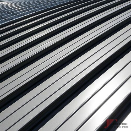 Sheets of Metal for Commercial Standing Seam Metal Roof Installation