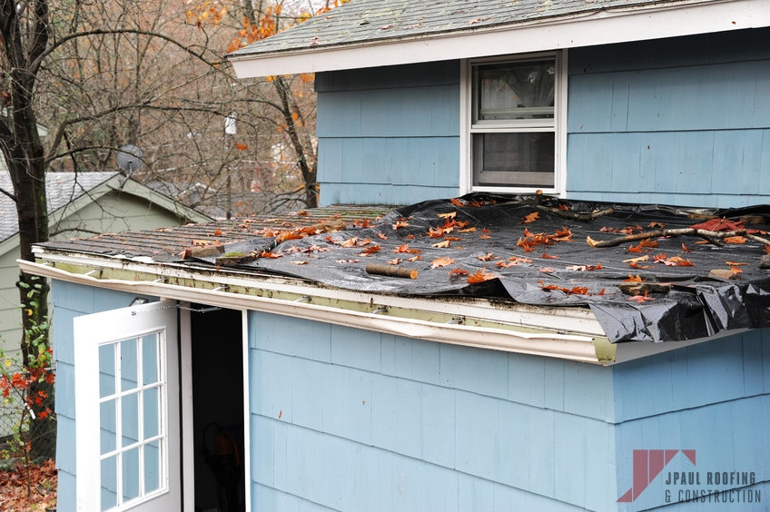 Roof Covered With Tarp Needing Emergency Roof Repair