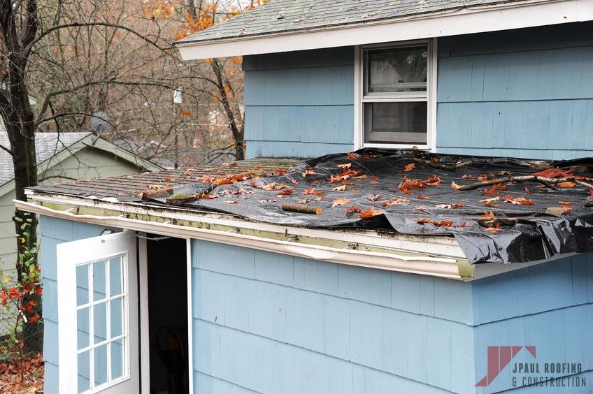 Roof Covered With Tarp Needing Emergency Roof Repair