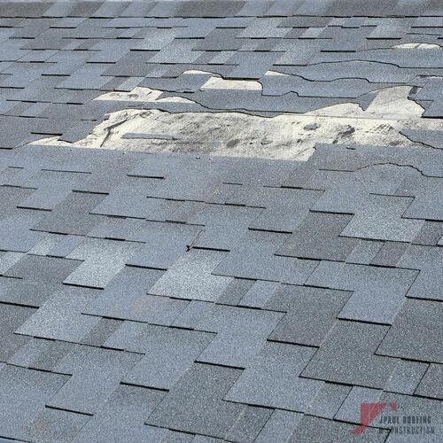 Roof Wind Damage Repair Needed